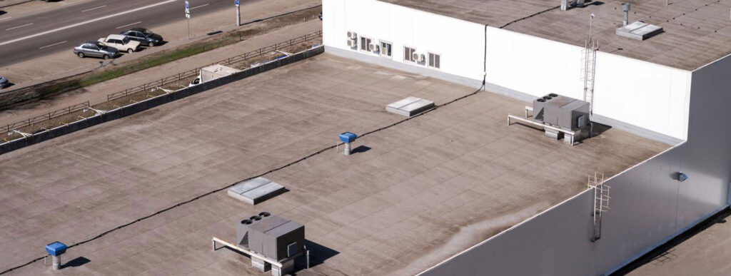 commercial building rooftop with AC units in Tucson