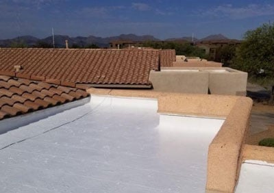 flat roof repair and coating on a Tucson house