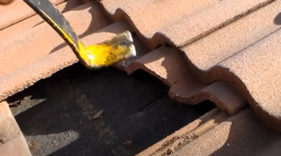 lifting roof tiles with a pry bar