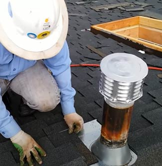Tucson roofer laying asphalt shingles down